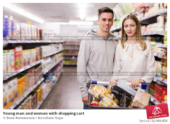 Young man and woman with shopping cart. Стоковое фото, фотограф Яков Филимонов / Фотобанк Лори