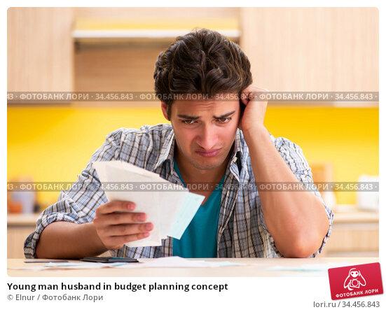 Young man husband in budget planning concept. Стоковое фото, фотограф Elnur / Фотобанк Лори
