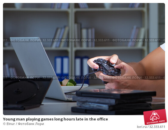 Купить «Young man playing games long hours late in the office», фото № 32333611, снято 5 июля 2017 г. (c) Elnur / Фотобанк Лори