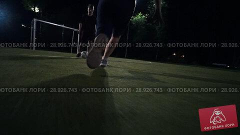 Купить «Young man runs to the ball», видеоролик № 28926743, снято 21 августа 2018 г. (c) Константин Шишкин / Фотобанк Лори