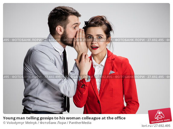 Купить «Young man telling gossips to his woman colleague at the office», фото № 27692495, снято 18 апреля 2019 г. (c) PantherMedia / Фотобанк Лори