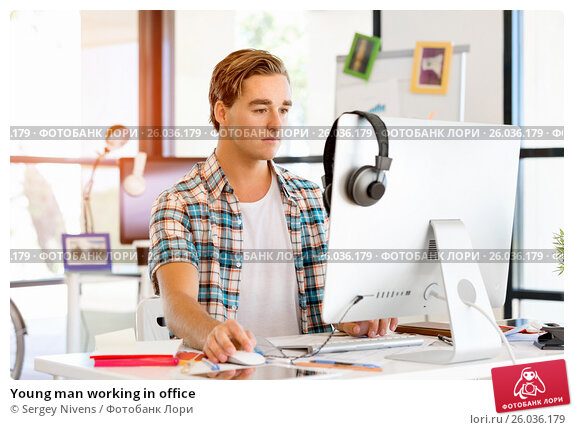 Young man working in office, фото № 26036179, снято 14 декабря 2014 г. (c) Sergey Nivens / Фотобанк Лори