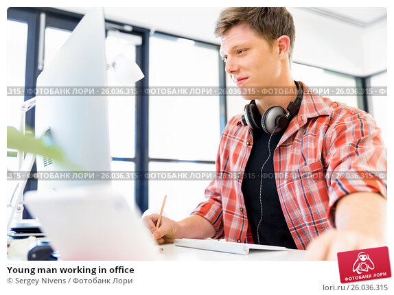 Купить «Young man working in office», фото № 26036315, снято 13 декабря 2014 г. (c) Sergey Nivens / Фотобанк Лори