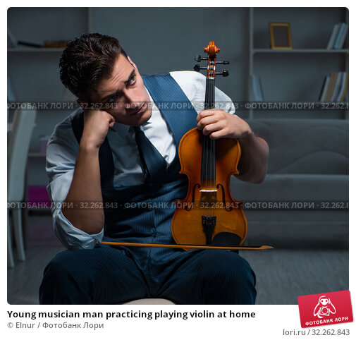 Купить «Young musician man practicing playing violin at home», фото № 32262843, снято 15 августа 2017 г. (c) Elnur / Фотобанк Лори