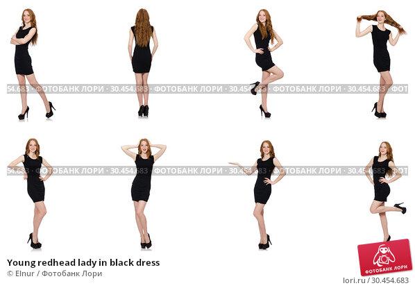 Young redhead lady in black dress. Стоковое фото, фотограф Elnur / Фотобанк Лори