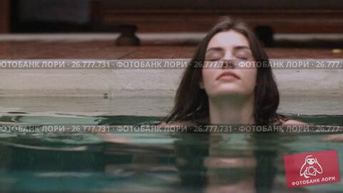 Купить «Young sexy woman swimming in pool», видеоролик № 26777731, снято 18 ноября 2018 г. (c) Denis Mishchenko / Фотобанк Лори