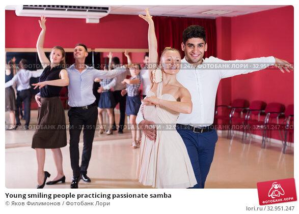 Young smiling people practicing passionate samba. Стоковое фото, фотограф Яков Филимонов / Фотобанк Лори