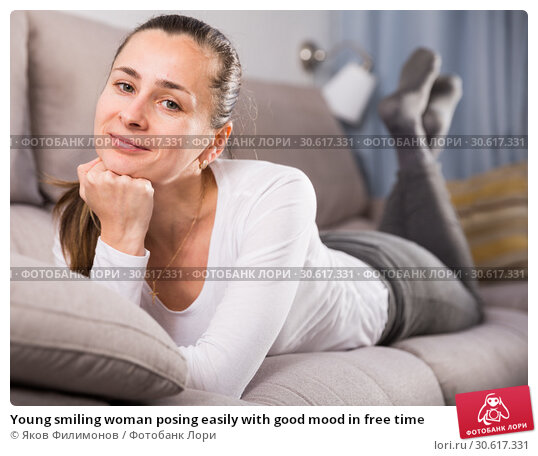 Купить «Young smiling woman posing easily with good mood in free time», фото № 30617331, снято 15 сентября 2019 г. (c) Яков Филимонов / Фотобанк Лори