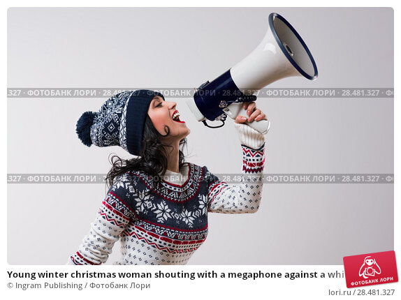 Купить «Young winter christmas woman shouting with a megaphone against a white background», фото № 28481327, снято 15 октября 2014 г. (c) Ingram Publishing / Фотобанк Лори
