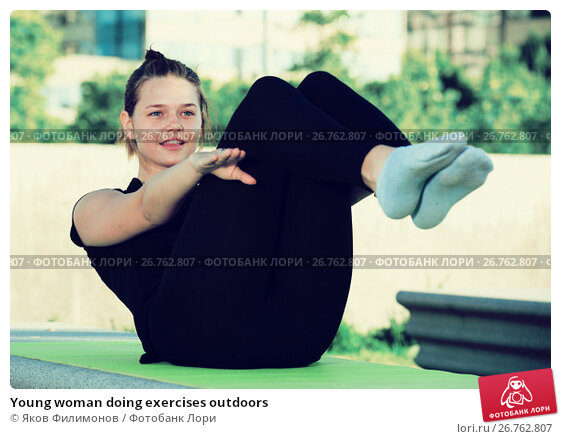 Купить «Young woman doing exercises outdoors», фото № 26762807, снято 5 июля 2017 г. (c) Яков Филимонов / Фотобанк Лори