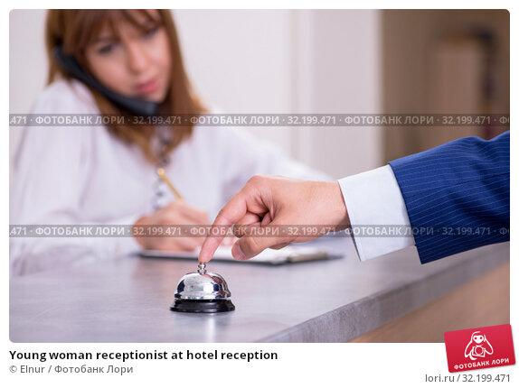 Купить «Young woman receptionist at hotel reception», фото № 32199471, снято 13 июня 2019 г. (c) Elnur / Фотобанк Лори