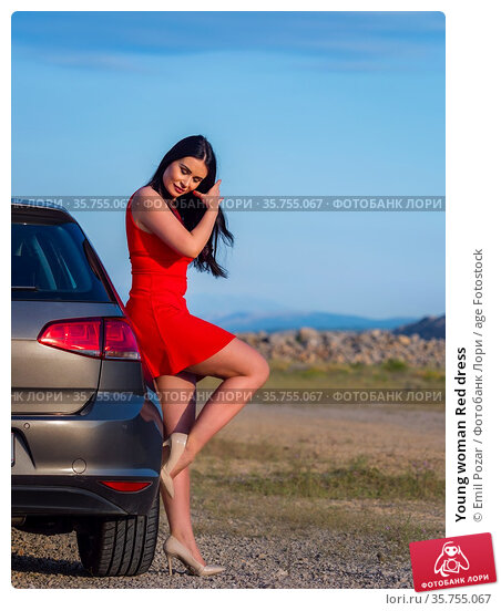 Young woman Red dress. Стоковое фото, фотограф Emil Pozar / age Fotostock / Фотобанк Лори