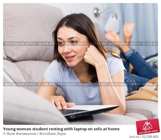 Купить «Young woman student resting with laptop on sofa at home», фото № 32538403, снято 18 апреля 2018 г. (c) Яков Филимонов / Фотобанк Лори