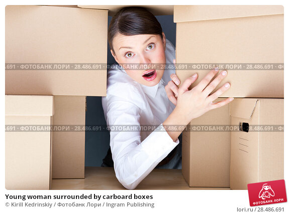 Купить «Young woman surrounded by carboard boxes», фото № 28486691, снято 31 октября 2011 г. (c) Ingram Publishing / Фотобанк Лори