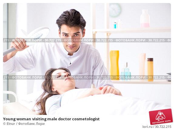 Купить «Young woman visiting male doctor cosmetologist», фото № 30722215, снято 16 ноября 2017 г. (c) Elnur / Фотобанк Лори